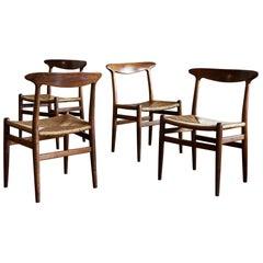 Hans Wegner Set of Four Model W2 Dining Chairs in Oak, Denmark, 1950s