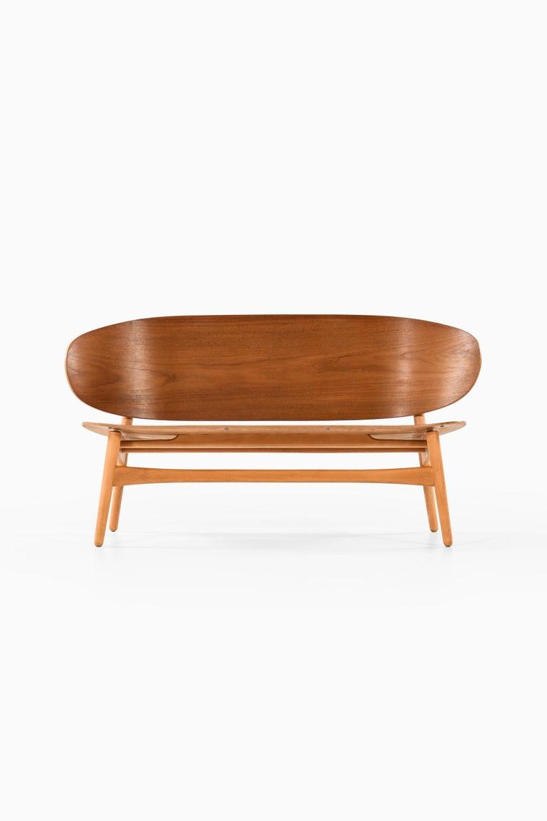 Rare shell sofa model 1935 designed by Hans Wegner. Produced by Fritz Hansen in Denmark.
