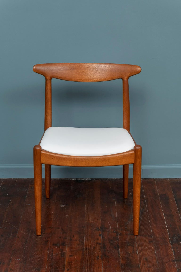 Hans Wegner design side chair for Johannes Hansen, Denmark. Perfectly refinished and newly upholstered in white leather, stamped.