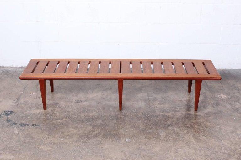 Solid teak bench designed by Hans Wegner for Johannes Hansen.