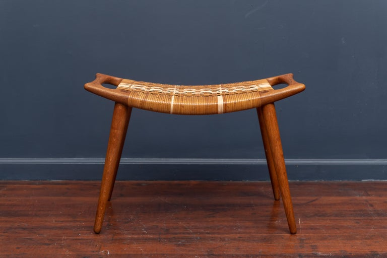 Hans Wegner teak and cane stool or bench for Johannes Hanse, Denmark. Restored caning which color match over time.