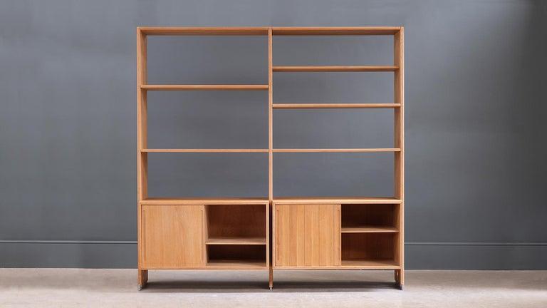 Amazing storage system / room divider in oak with great details designed by Hans Wegner for R Y Mobler, Denmark.