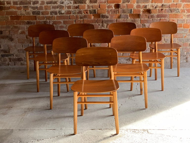 A magnificent and extremely rare set of ten Hans Wegner model 4101 teak and beech dining chairs for Fritz Hansen, Denmark, circa 1950, the chairs with bent plywood teak backrests and seats float above a solid beech frame with makers stamp to