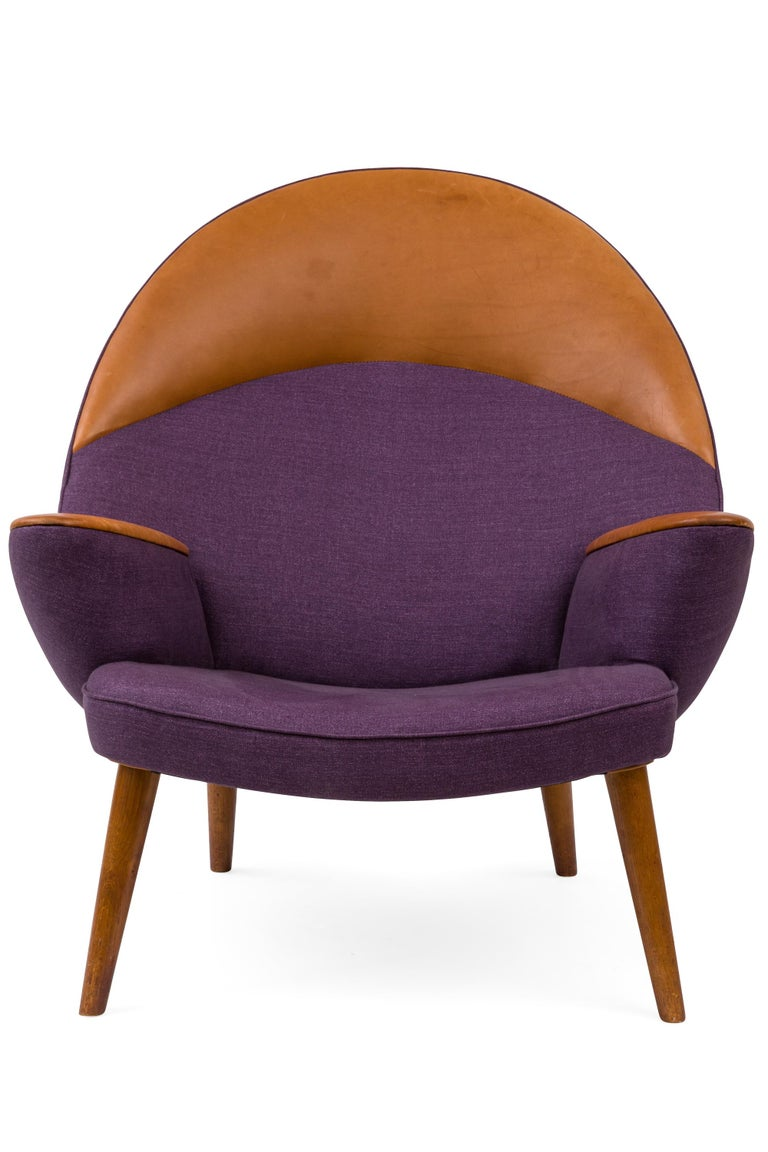 A rare Denmark oak, leather and Loro Piana cashmere upholstered lounge chair executed by Johannes Hansen. Only ten examples of the model are known to exist.