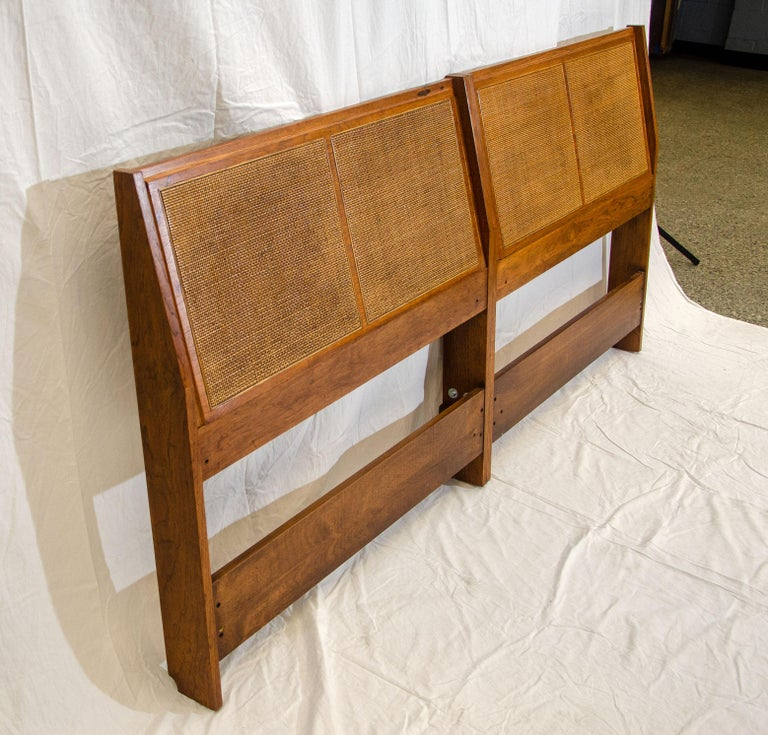 This original pair of twin size headboards were joined together to be used as a king size headboard. The headboard can also be split back into twin headboards by removing five bolts, a very versatile piece of furniture. The caning is original and in