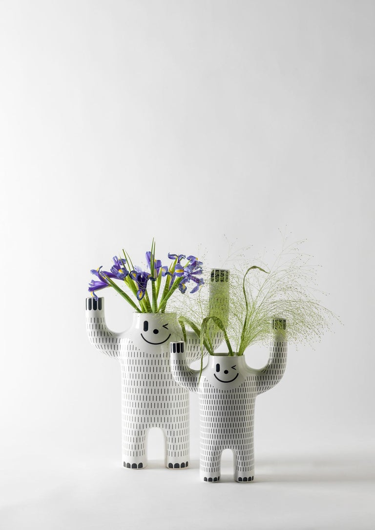 Glazed ceramic vase in white with decorations in black. A ceramic collection which carries Jaime Hayon's unmistakable character and humour, the Happy Yeti vases are a new version of the Happy Susto vases.