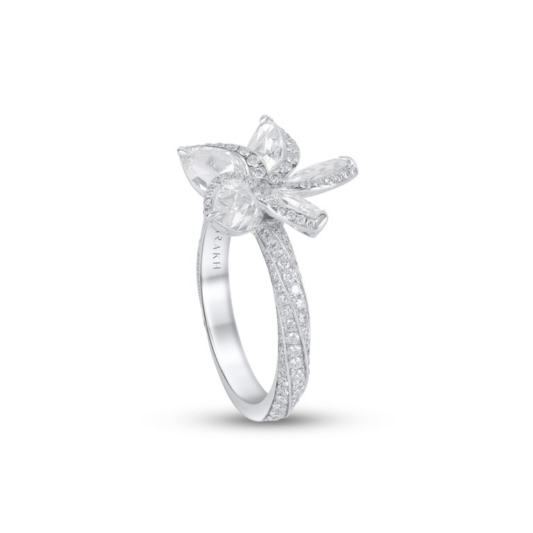 This beautiful floral ring features shimmering pear rose cut diamonds and brilliant round in pave setting resembling petals, with a diamond studded shank crafted in 18 karat white gold.   The ring is studded with 141 round and 5 rose cut pear