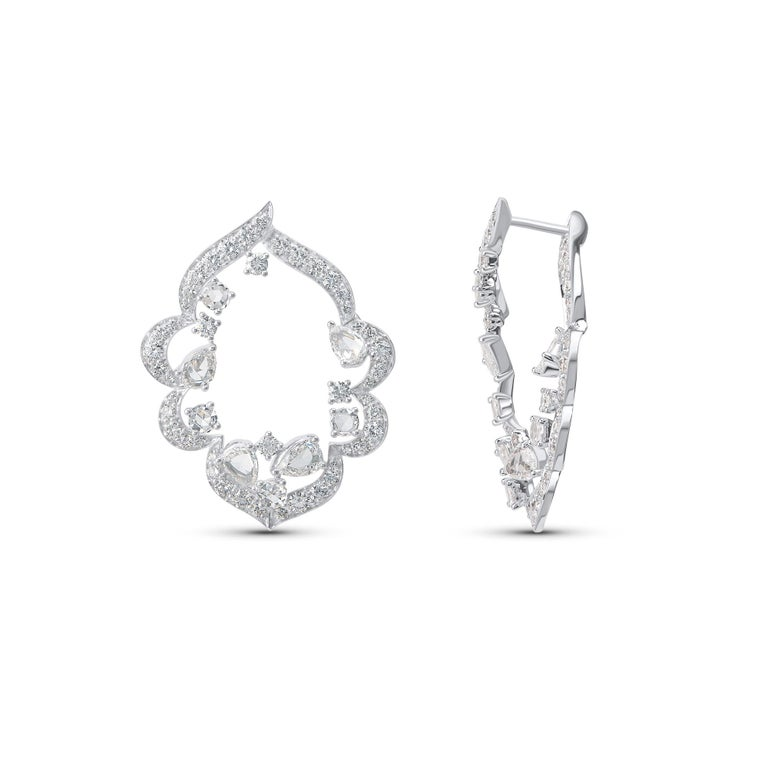 Inspired by the grand Indian havelis (royal abode) of yesteryear, these contemporary inside out earrings are crafted in 18 KT white gold and are studded with a total of 110 diamonds including 94 brilliant, 8 rose cut round and 8 rose cut pear