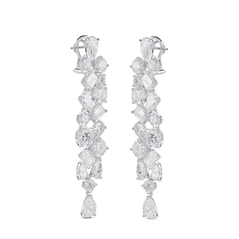 Droplets of individually GIA certified high carat 16 round brilliant cut, 12 emerald cut  and 6 pear cut diamonds descend into this show-stopping pair of long dangling earrings.          The total diamond weight of these 34 diamonds is 32.30 CT and