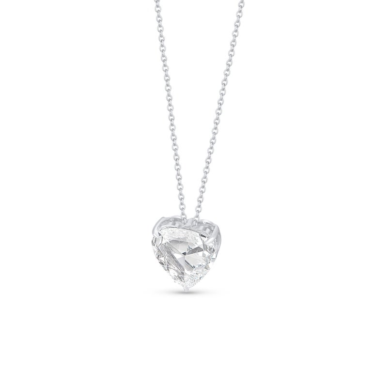 Elegantly designed, this Rose Cut Heart Shaped Solitaire pendant is designed in 18-karat white gold. The total diamond weight of is 1.66 carats and the diamonds are graded as E color and VS2 clarity.  The pendant will be accompanied with an 18-inch