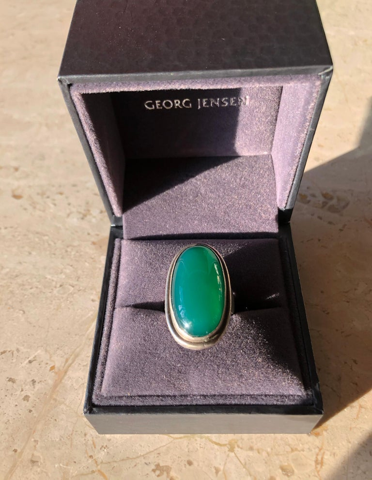 Stunning chrysoprase stone in sterling silver setting ring designed by Harald Christian Nielsen for Georg Jensen, circa 1950's.  Ring is a finger size 7 to 7.25 and is signed Georg Jensen, 46E, Denmark.  Ring comes with a Georg Jensen box as seen in