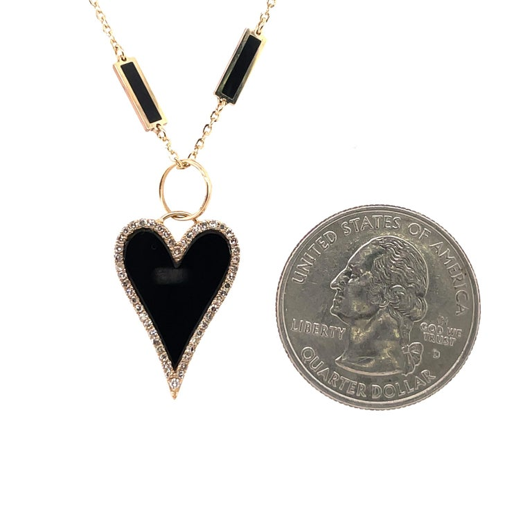 Italian 14K Yellow gold necklace featuring on diamond onyx and gold heart pendant on a onyx and gold trim chain.  Can mix and match pendant/necklace.  Heart comes in different colors.  Paperclip necklaces are available and more fashion