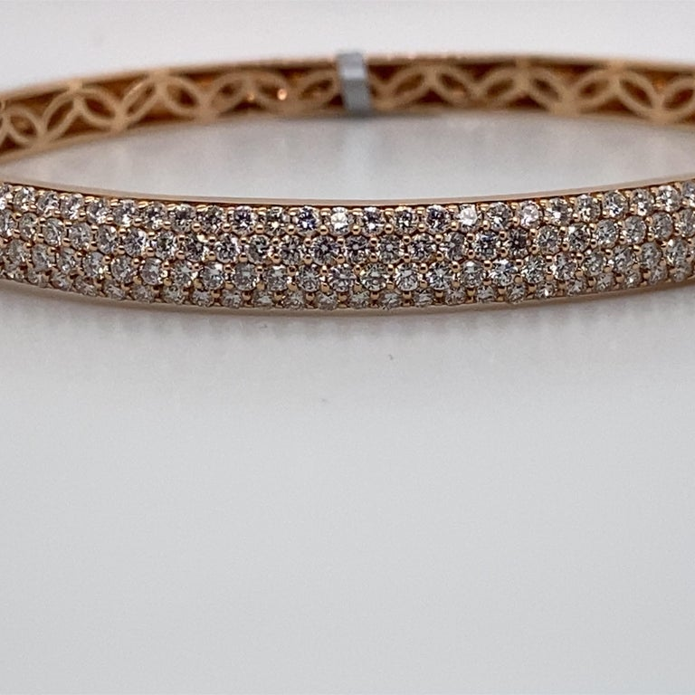 18K Rose gold bangle bracelet featuring  three rows of 172 round brilliants weighing 0.85 carats. Color G-H Clarity SI   Great for stacking! Available in yellow & white gold.