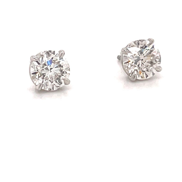 Diamond stud earrings weighing 2.04 carats in a 4 prong champagne setting, 14k white gold.  Color I Clarity SI3-I1