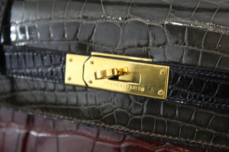 For sale an amazing piece from Hermes a Kelly 32 in Alligator with black shoulder strap. A really hard to find piece perfect for collectors.  Used but  in excellent condition/ Hardly no signs of wear on it.   Sold with dust bag.  No CITES
