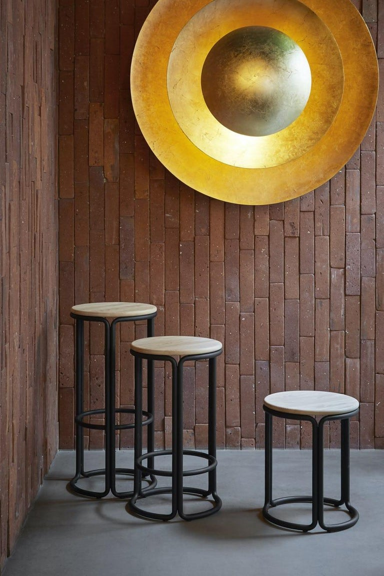 The Hardie stool is a clean-lined and no-nonsense piece. The stool is made of three identical bent metal tube columns and a seat. The tubes pair up where they join, adding rigidity and stability to the design. The Hardie stool is a versatile