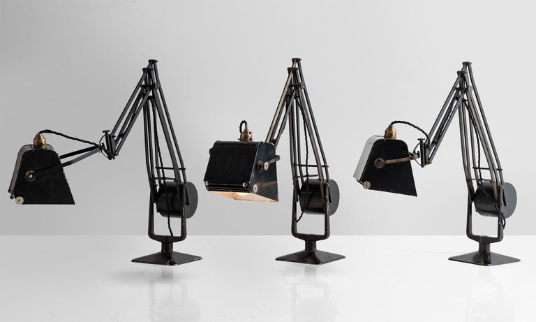 Magnifying work lamp in original black finish with weighted counterbalance. Each lamp has the original makers mark in tact.