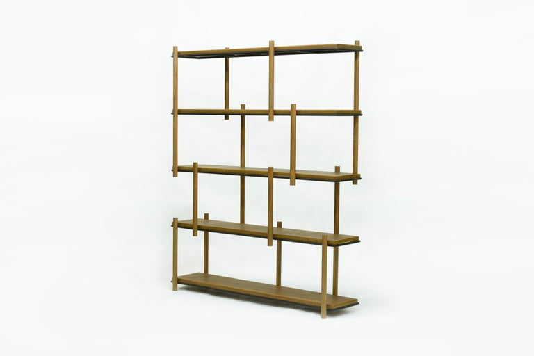 This bookshelf was inspired by Mondrian masterpieces and the orthogonal lines painted by him. In his paintings, intersecting lines are often filled by primary colors (red, yellow and blue), but here such task is up to the user. Books, art pieces,