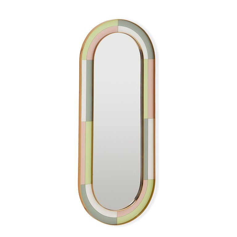 Avant Glamour. Finally, an ultra-chic full-length mirror. Featuring glass panes back-painted in early-morning inspired shades and recessed between two generous brass frames. The ultimate expression of Modern American Glamour, our Harlequin Capsule