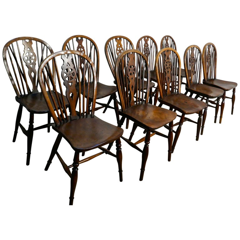 Harlequin Set of 10 Victorian Beech and Elm Wheel Back Windsor Dining Chairs