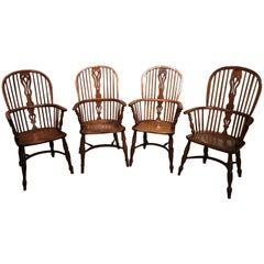 Harlequin Set of Four Yew Wood High Back Windsor Armchairs