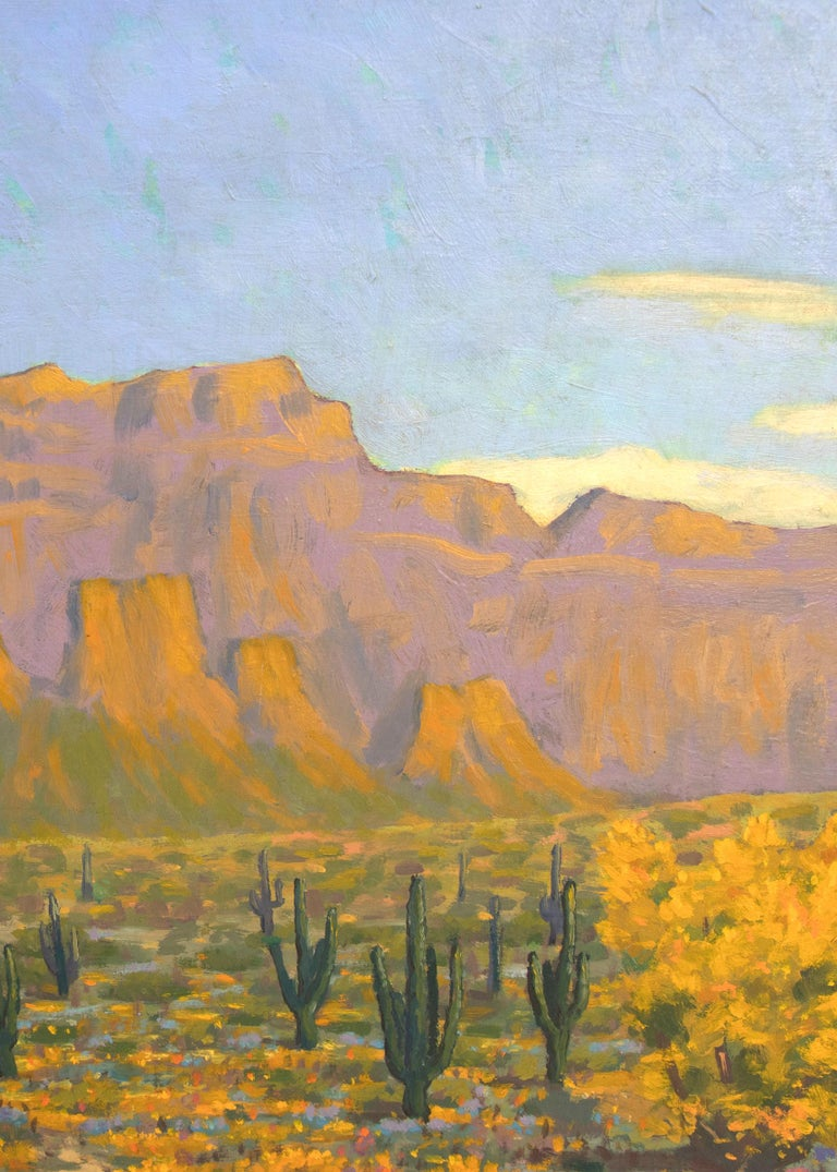 Vintage Southwestern Landscape Oil Painting with Mountains/Mesas, Saguaro Cactus and Trees and Brush in Autumn Colors by Harold Skene (1883-1978).  Painted in shades of blue, green, golden yellow, orange, purple, tan and white. Presented in a custom