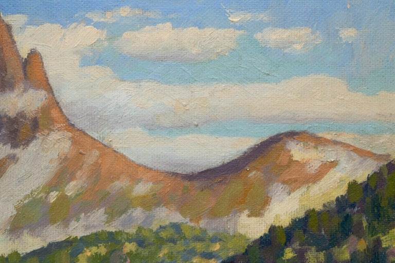 Lizard Head, near Telluride, vintage 1959 Colorado mountain landscape painting with a lake and green conifer/pine and aspen trees, snow covered peak and bright blue sky with white clouds. Oil on board, signed lower right, dated and titled verso.