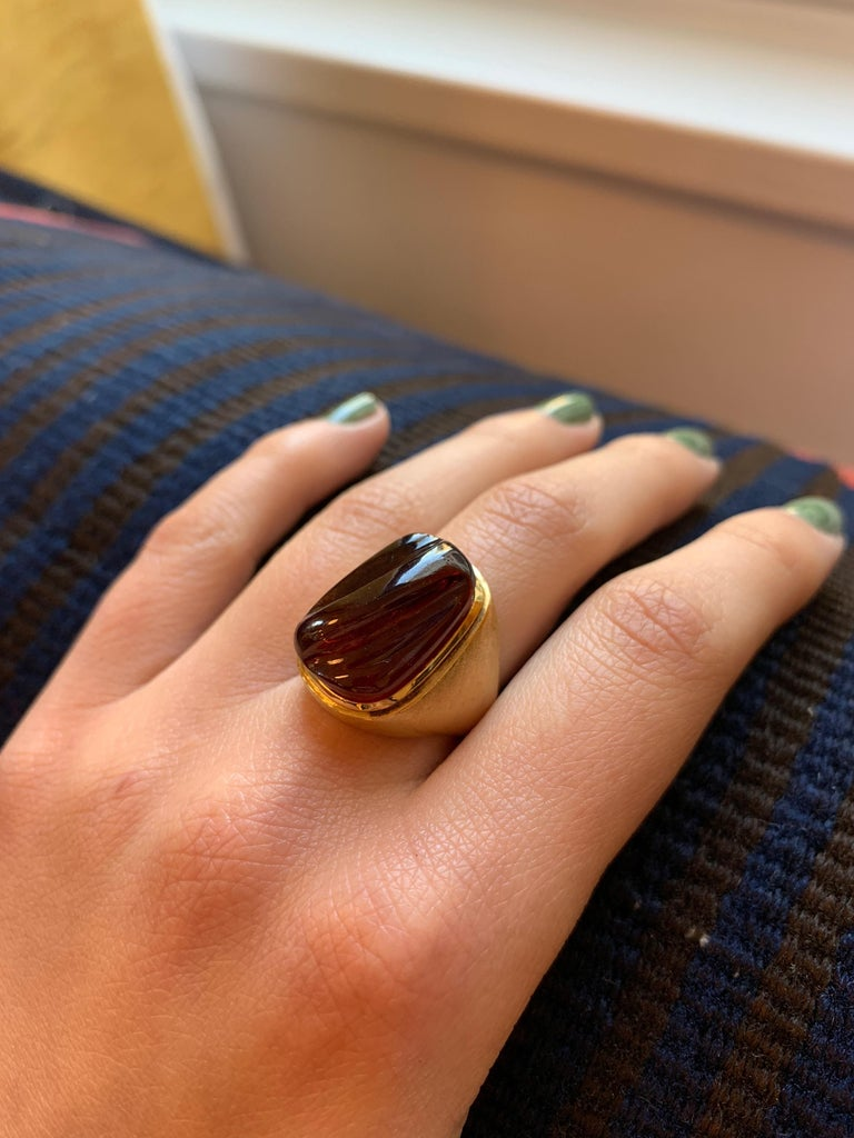A forma livre carved rubellite and 18 karat gold ring, by Haroldo Burle Marx, c. 1970.  The ring is size 6. Signed Burle Marx. Stamped 750, IND BRAS, GB791.