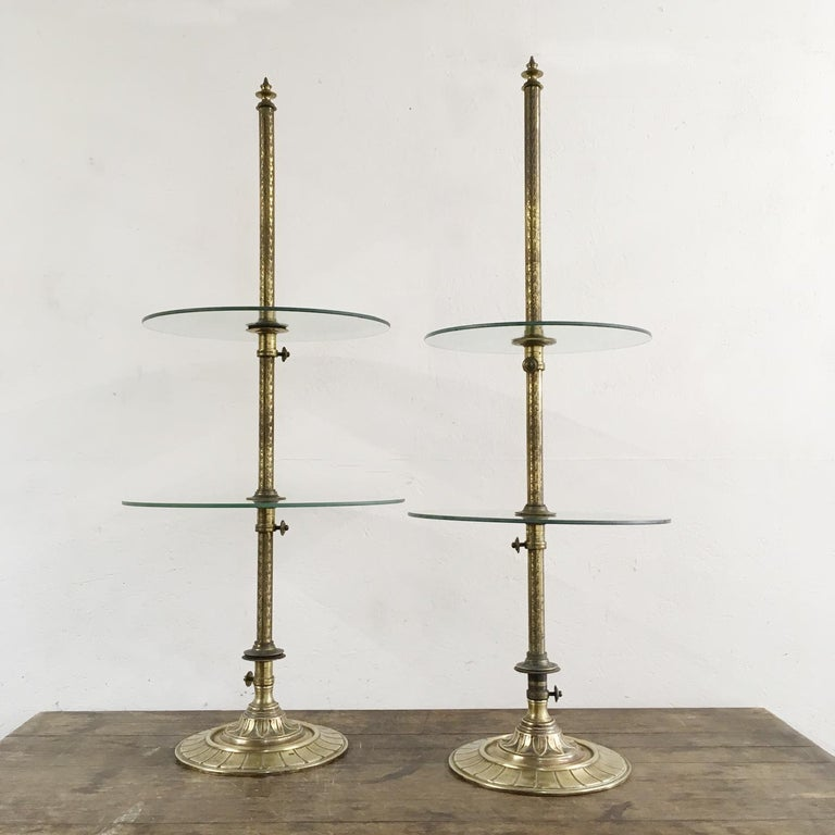 Harris & Sheldon Edwardian brass confectionary shop display stands  1910  A pair of antique Edwardian display stands  The brass work is decorated with small floral patterns and leaf details on the foot  The makers stamp and reg mark cast