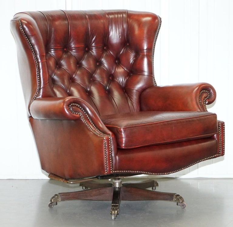 We are delighted to this stunning 1 of 2 Art Forma for Harrods London hand dyed oxblood leather oversized wingback library reading lounge chair with matching ottoman   I have another one of these armchairs listed under my other items that is