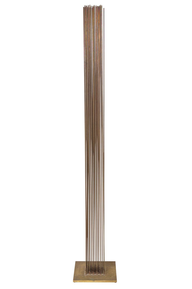 Bertoia's sonambient sculptures are one of his most sought after forms. This one being six feet tall with a dense formation of rods makes it that much more desirable.