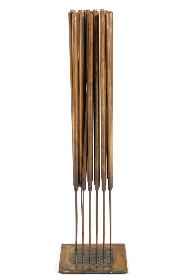 An unusual and wonderful example of Bertoia's sonambient sculptures. It has a very strong sounding quality for it's size due to the relationship between the rods and the cattails at the top of the rods. A rare piece for a collector of Bertoia's work.