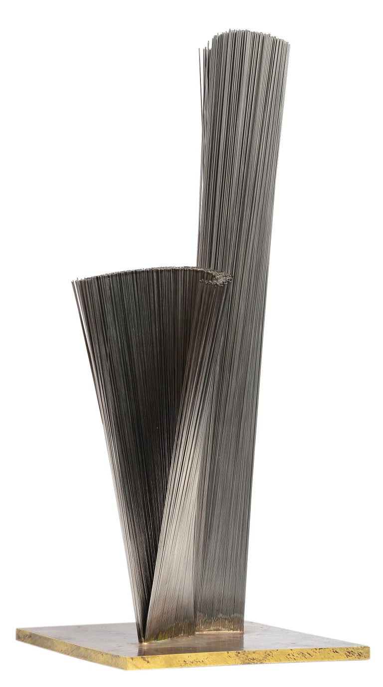 An outstanding example of Harry Bertoia's bundled wire sculptures.  This example is one of the largest tabletop versions he ever created. Thousands of thin stainless steel wire bundled and welded together onto a solid naval brass base.   Two