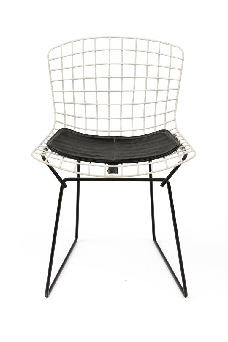 A universally recognized design, these Bertoia child's chairs have black bases and the original seat pads.