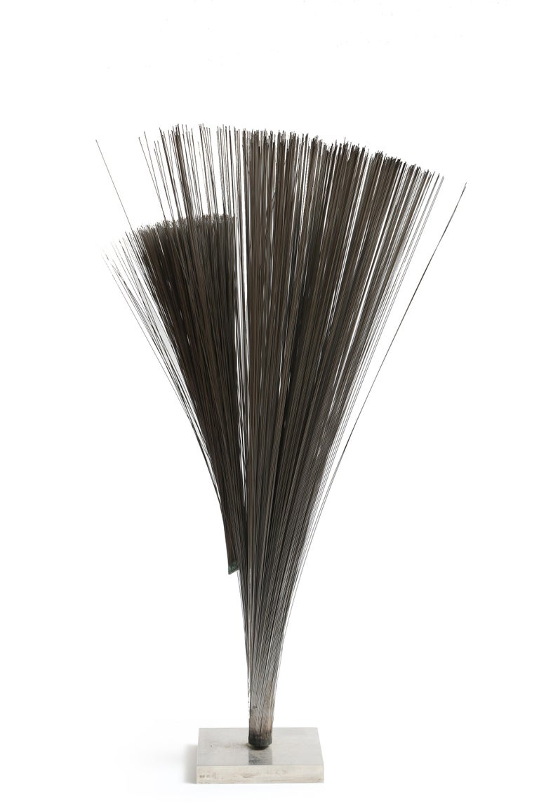 Harry Bertoia created numerous bundled wire sculptures from the late 1950s until the mid-1970s. This example is a large and interesting table-top variation. Sculpture comes with authentication from Celia Bertoia.