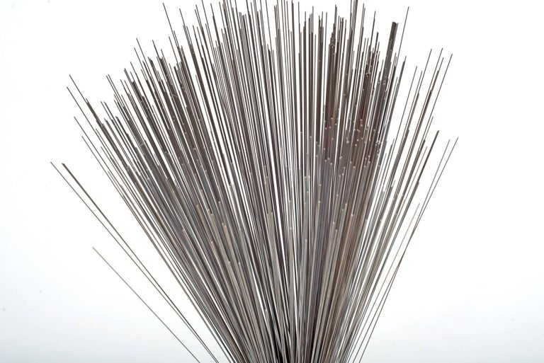 Early example of the iconic Spray sculpture by Harry Bertoia. A bundle of stainless steel wires are gathered and inserted into a heavy base. The loose ends are left to drape gracefully, creating the namesake