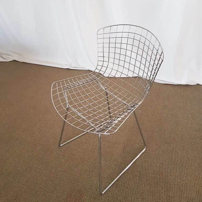 Side chair with frame in welded steel wire, polished and chrome plated.