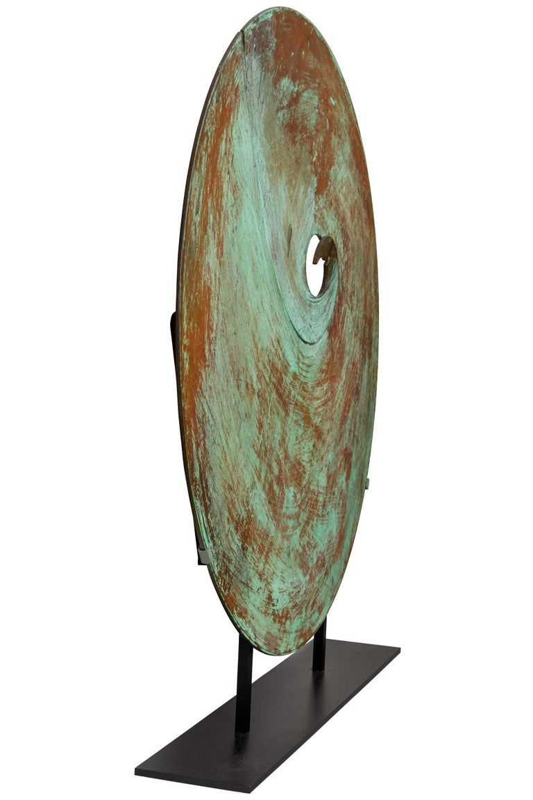 All of Bertoia's solid gongs possess a wonderful graphic quality but this one has a spiral design that stands out amongst them. It is mounted in a stand for display purposes but when hung properly can also be sounded.
