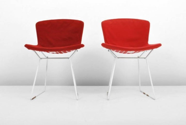 These early production and all original Harry Bertoia for Knoll International wire chairs are one of the most iconic designs of Mid-Century Modernism. The chairs are constructed of welded steel rods with a white powder coated finish and retain the