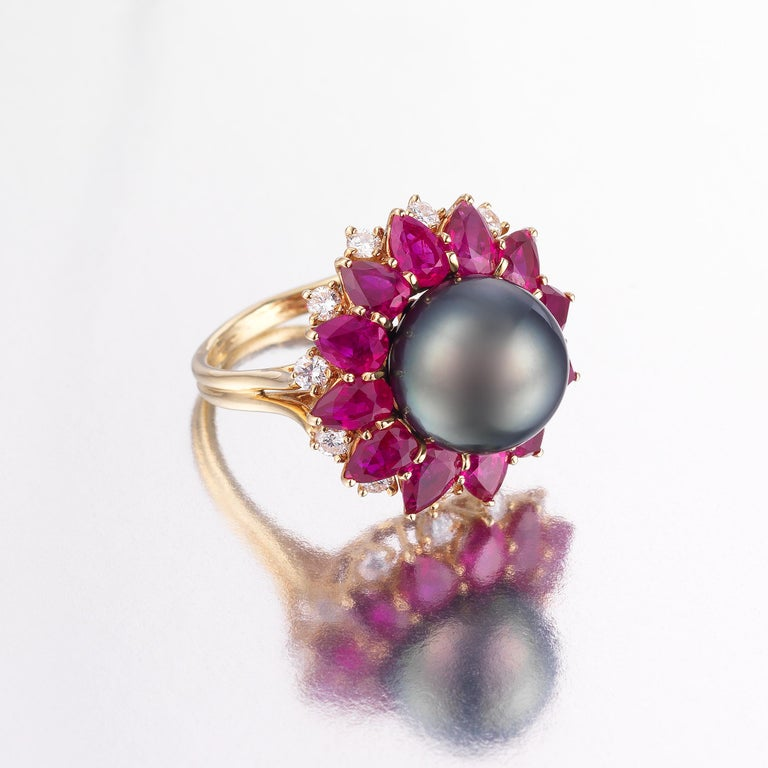 Splendid one-of-a-kind Harry Winston ring radiating 1970s glamour and showcasing approximately 5 carats of vividly-hued rubies and 1 carat of fine white diamonds, along with an eye-catching black Tahitian pearl that completes a bold and striking