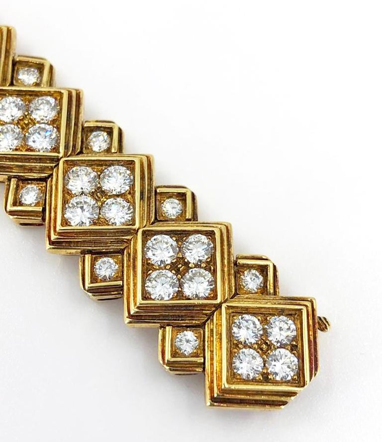 A vintage Harry Winston diamond bracelet in 18k gold; designed as a series of diamond-set square-shaped links with tiered borders, enhanced by smaller similar links, measuring18.0 cm and set with approximately 20 carats of diamonds.  Signed Winston,