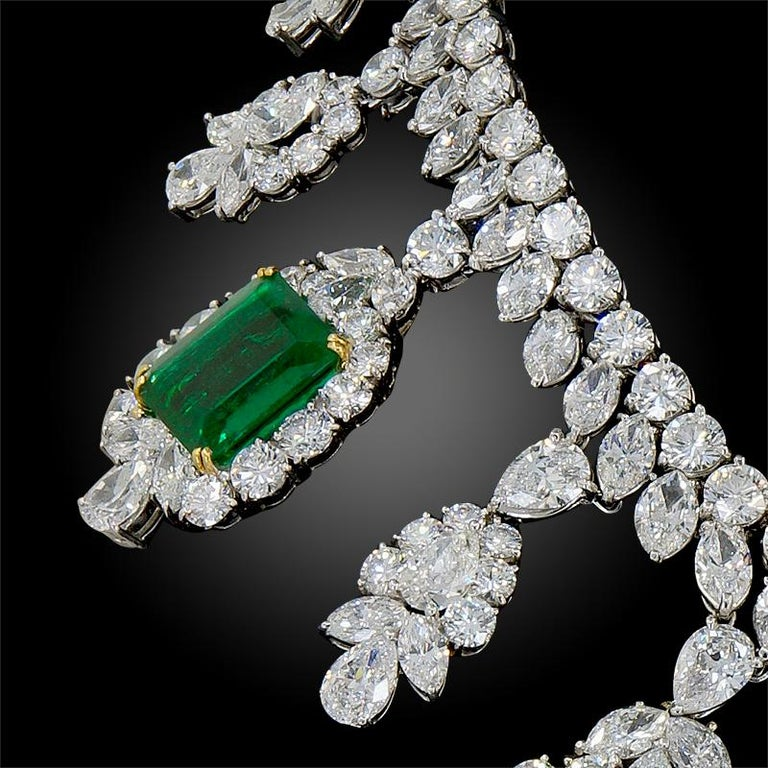 Impressive rectangular Colombian emeralds, circular, pear and marquise-cut diamonds, platinum and 18k gold, 15 ins., maker's mark, Signed Harry Winston. Total diamond carat weight is approx. 92 cts. Total emerald carat weight is approx. 70 cts.