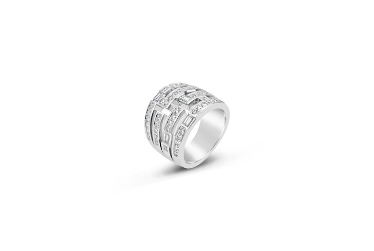 Showcases multiple lines of round and baguette diamonds, set in a polished platinum mounting. Diamonds weigh approximately 1.44 carats total. Made, signed, and numbered by Harry Winston. Size 6.5 US (not sizable).