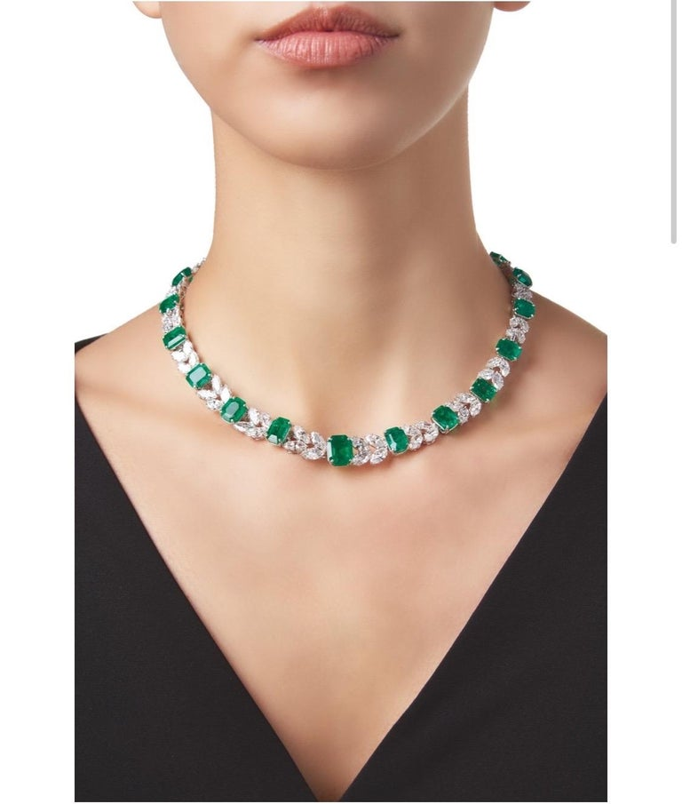 50 carats of Colombian emeralds, 30 carats of diamonds make up this one of a kind Harry Winston necklace. Set with 21 emerald-cut emeralds, spaced by marquise-shaped diamonds, internal circumference 15¾ inches, detachable into sections measuring 7,