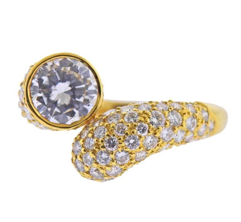 Harry Winstone 18k gold bypass ring, with a center GIA certified 2.24ct D/VVS2 diamond, surrounded with side approx. 1.70cts in diamonds. Ring size - 8.25, ring top is 17mm wide. Marked: 750 BR, Winston. Weight - 10.1 grams.