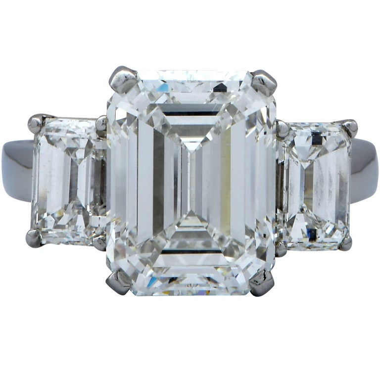 Spectacular diamond engagement ring crafted by Harry Winston and hand forged out of fine platinum. Showcasing an elegant GIA graded emerald cut diamond weighing 5.11cts, H color, VS2 clarity, this ring is a showstopper. Flanking the center diamond