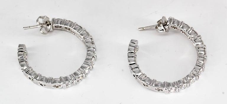 Elegant diamond and platinum hoop earrings from the