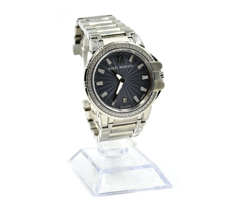 Movement: Swiss made automatic movement Function: hours, minutes, date Case: round 36mm stainless steel case with diamond bezel, sapphire protective crystal, screw-down crown, solid case-back, waterproof to 200 meters Dial: grey dial with diamond