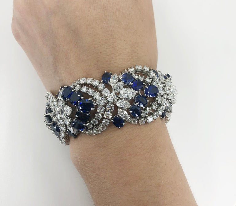 HARRY WINSTON Sapphire Diamond Articulated Bracelet in Platinum. An exceptionally crafted articulated bracelet by Harry Winston designed as a continuous row of pear, marquise and round brilliant-cut diamonds interspersed by angled rows of