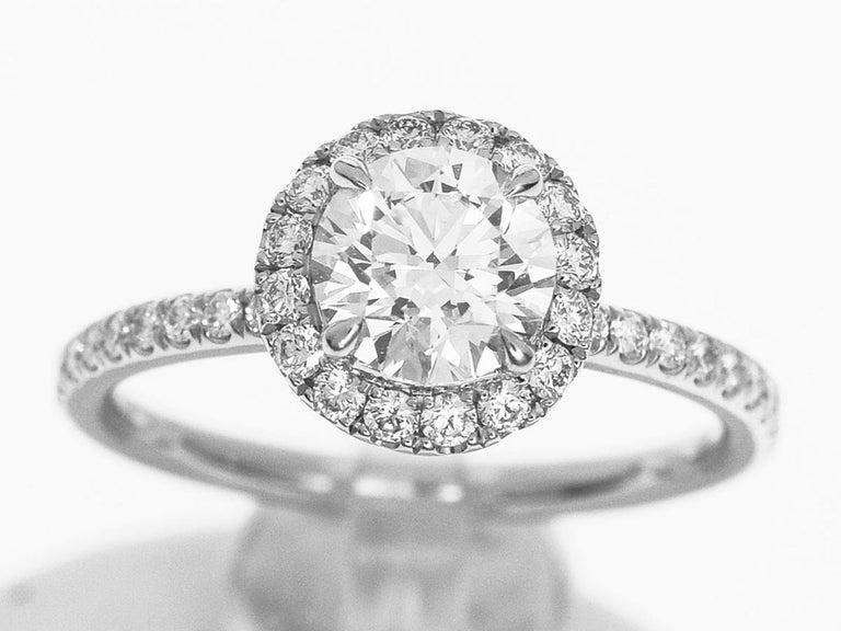 Brand:HARRY WINSTON Name:The One, Round Brilliant Diamond Micropavé Engagement Ring Material :1P Diamond(D0.72ct D-VS1-VG), Side Diamonds, PT950 Platinum Comes with:Harry Winston Box, Case, HW Certificate (Dec 2015),GIA certificate(Feb 2015), HW